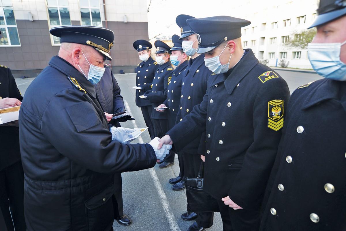 Parade participants receive departmental medals